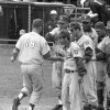Don Merchant is congratulated by his Alconbury team-mates after his home run versus London (courtesy of the Dutch National Archives)